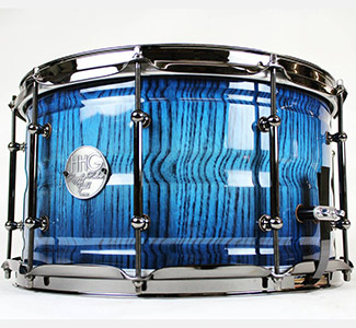 14 x 7 contoured ash stave snare drum with electric blue burst high gloss lacquer finish and black nickel hardware
